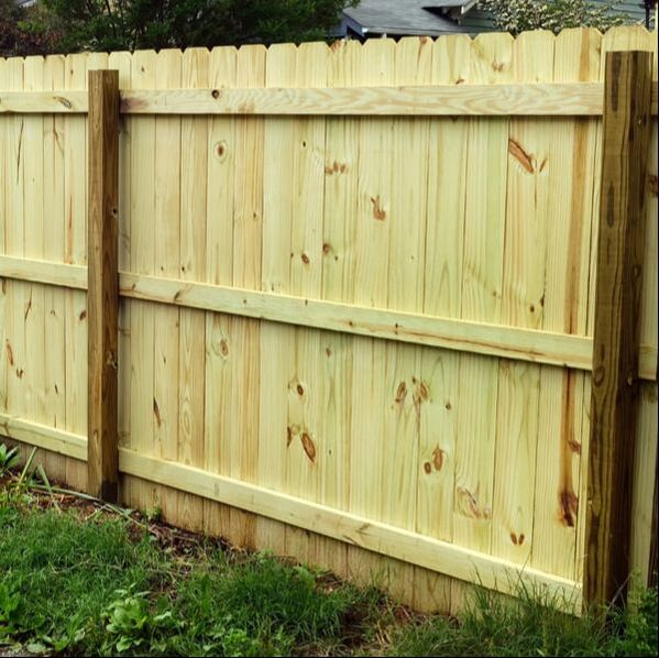 Dog eared cedar privacy fence with treated square posts. The Fence is six feet tall and has three cross bars to make the fence very stable.